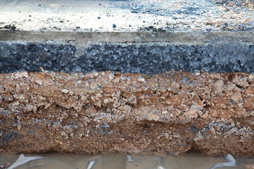 Layer soil beneath asphalt cement concrete