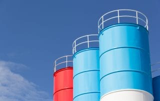 Blue and red steel silo against blue sky