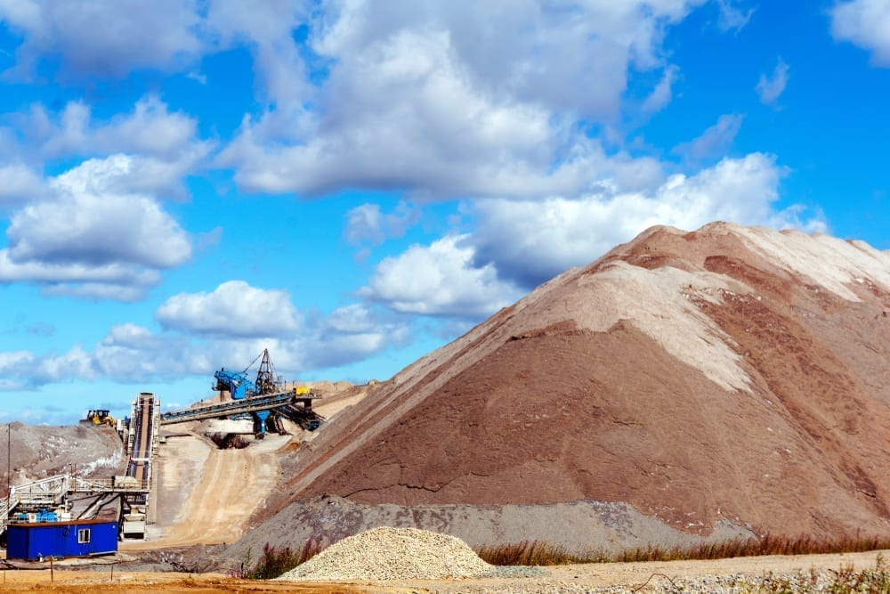 Dumps of mined rock with a system of belt conveyors and stackers, general view